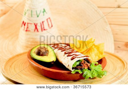 Plate of breakfast  large burrito and nachos