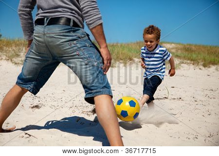 Father And Son Enjoying Football Game