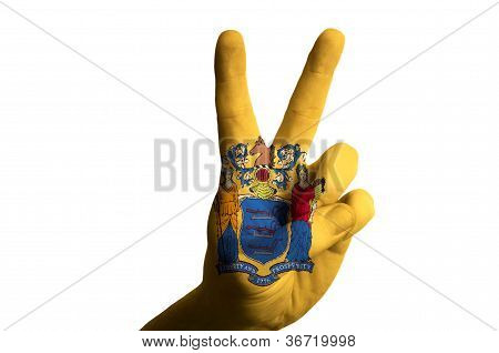 New Jersey Us State Flag Two Finger Up Gesture For Victory And Winner Symbol Made With Hand