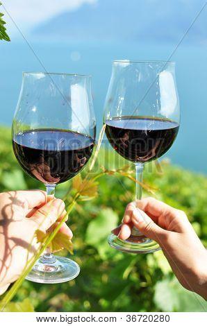 Two hands holding wineglasses. Lavaux region, Switzerland