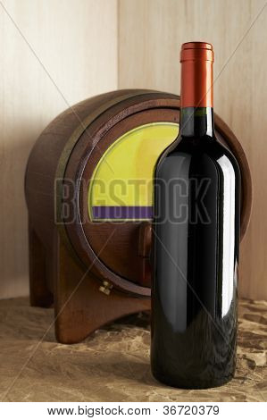 Wine List Design Series: Bottle of red wine with barrel and copy space