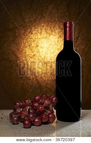 Wine List Design Series: Bottle of red wine and grapes with copy space