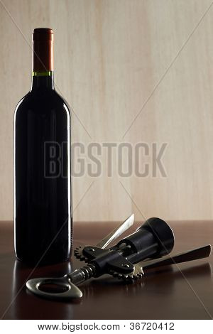 Wine List Design Series: Bottle of red wine with corkscrew and copy space