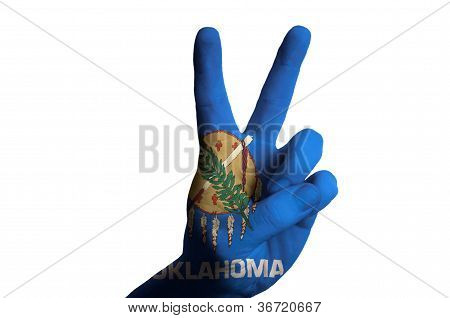 Oklahoma Us State Flag Two Finger Up Gesture For Victory And Winner Symbol Made With Hand