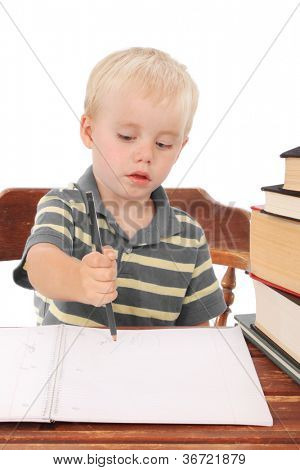 Little boy at a desk, doing homework