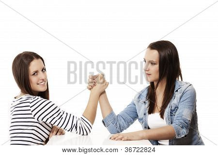 two arm wrestling teenagers