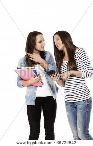 two communicating teenage students with a smartphone