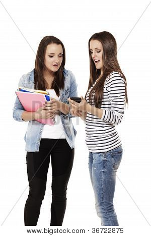 two teenage students looking at a smartphone