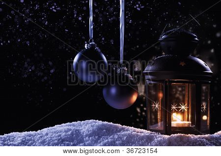 lantern with two hanging christmas balls