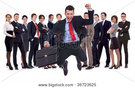 business man holding briefcase jumping with his business team formed of young businessmen and businesswomen standing over a white background