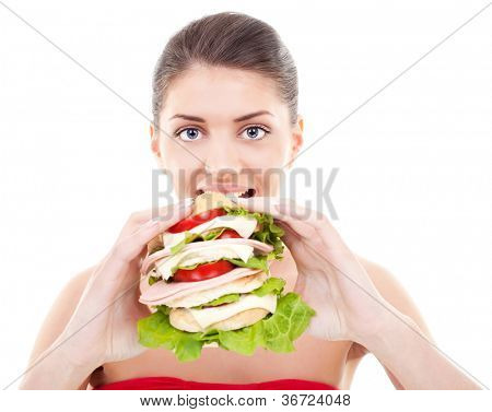 smiling young woman preparing to eat a huge sandwich on white background
