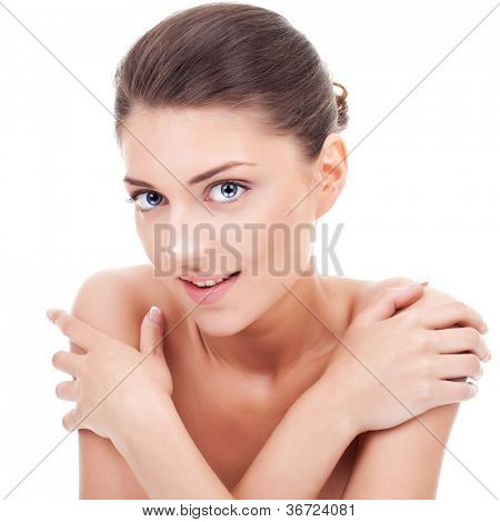 beauty skin care young woman looking at the camera with hands crossed on shoulders close-up