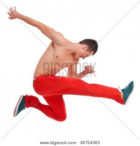 cool looking dancer makes a difficult jump over white