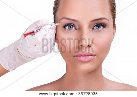 Beautiful woman gets injection in her face, correction upper lids
