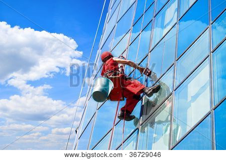 Washer wash the windows of high skyscraper, high risk work