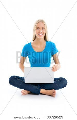 Portrait of a happy young girl with laptop computer isolated over white background
