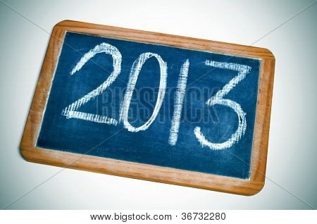 number 2013, as the new year, handwritten in a blackboard