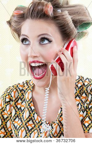 Portrait of funny surprised woman using telephone.