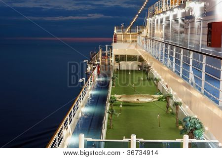 Ground for minigolf on deck of cruise ship.