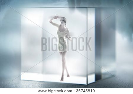 Cute blond lady imprisoned in a glass cube