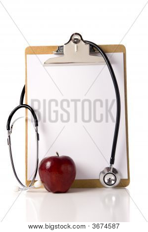 Doctor'S Clipboard With An Apple And A Stethoscope
