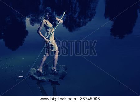Fine art image of a woman sailing a leaf
