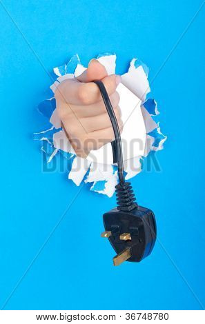 Hand holding electric plug