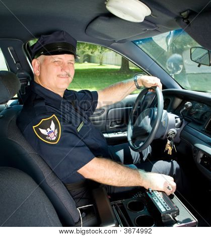 Police Officer Drives Squad Car