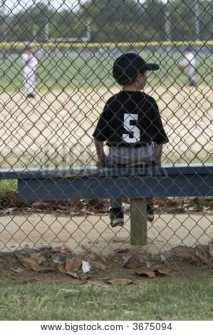 Baseball Player On Bench