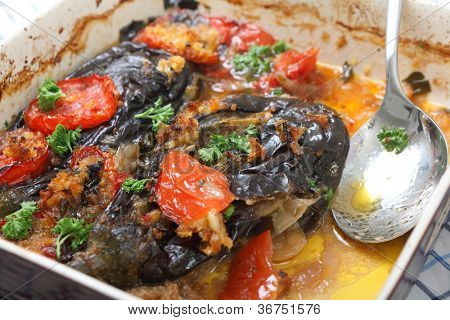 The Greek and Turkish speciality Imam Baildi, eggplant baked in olive oil with onion, tomato, garlic, parsley, topped with bread crumbs.