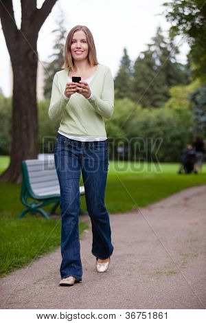 Woman Using Cell Phone in park.