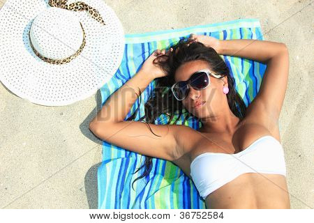 Young woman enjoying the summer time on the beach