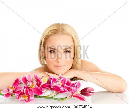 Portrait of pretty woman enjoying dayspa, picture of young beautiful lady with pink orchid flower isolated on white background, zen balance, beauty treatment, luxury spa ralaxation