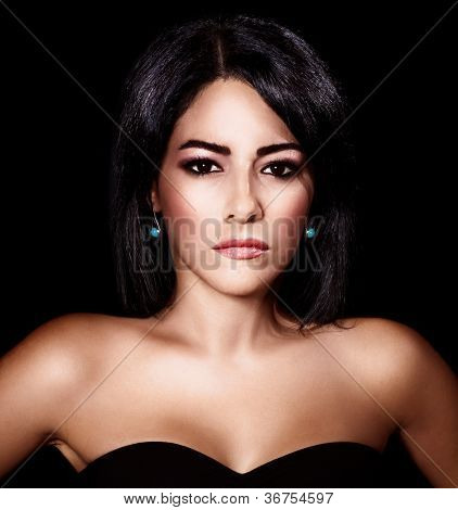 Photo of beautiful sexy woman isolated on black background, closeup portrait of stylish glamorous female, attractive brunet young lady with fashionable makeup, elegant arabic model