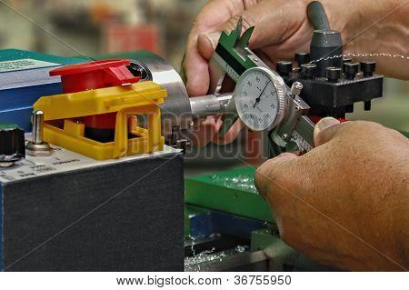 Measuring Lathe Work With Caliper