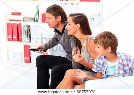 Happy family emotionally watching television at home.