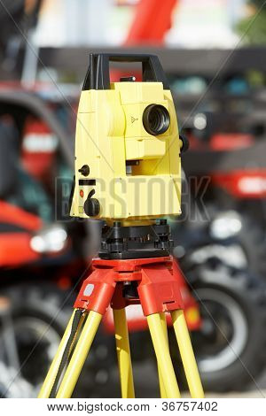 Surveying measuring equipment level transit theodolite on tripod at construction building area site