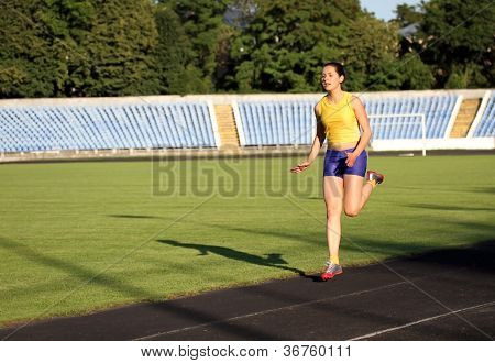 Athletic Girl On The Track .