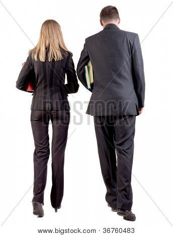 Back view of walking business team. Going young couple in suit with books go get an education. Rear view people collection. backside view of person. Isolated over white background