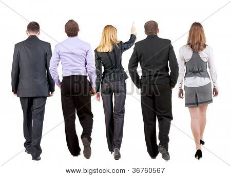 back view of walking business team.  business people going. woman pointing in distance. Rear view people collection. backside view of person. Isolated over white background.