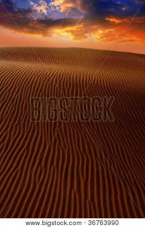 Desert dunes dramatic sunset in Maspalomas Oasis Gran Canaria at Canary islands