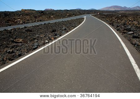 Black volcanic soil and road detail in Lanzarote Canary Island