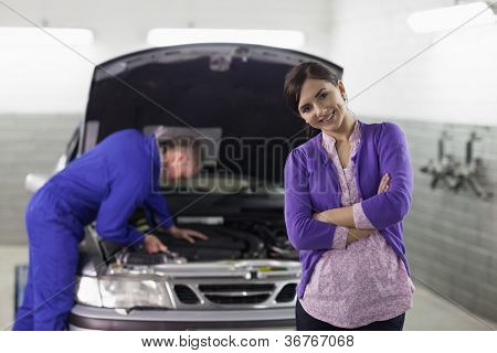 Front view of a smiling client looking at camera in a garage
