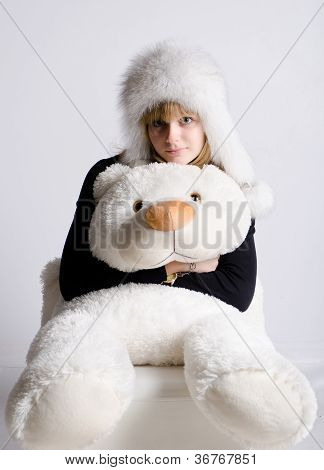 Girl In A Fur Hat With A Bear