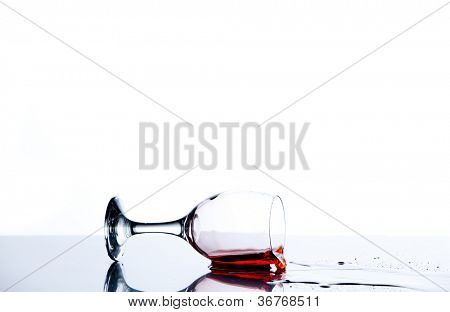 Red trickle flowing on the floor of a glass