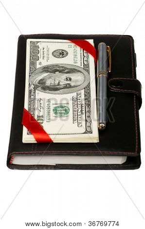 Heap of dollars and notepad isolated on a white background