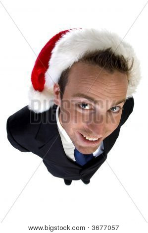 Posing Businessman With Christmas Cap