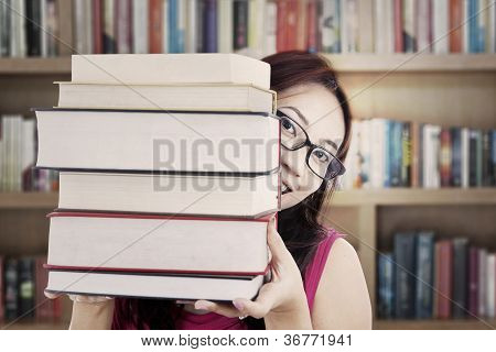 Student Holding Thick Books
