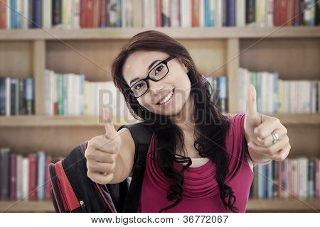 Successful Student Showing Thumbs-up