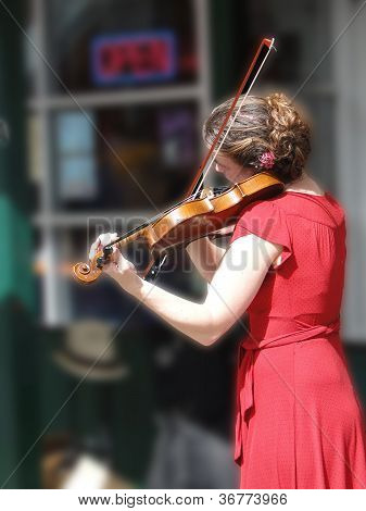 Female Violinist Entertains The Crowd